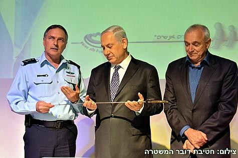 PM Netanyahu holding Jabotinsky's sword.