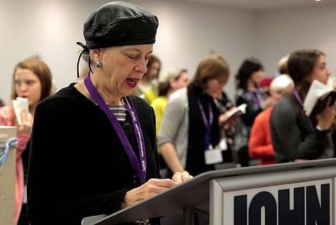 Ruth Lockshin of Toronto leads a partnership minyan at a conference in New York of the Jewish Orthodox Feminist Alliance, December 2013.