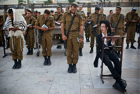IDF soldiers praying at the Kotel.