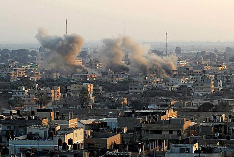 Smoke rises after The Israeli Air Force bombed terrorists' smuggling tunnels in Rafiah at the Gaza-Egypt border.