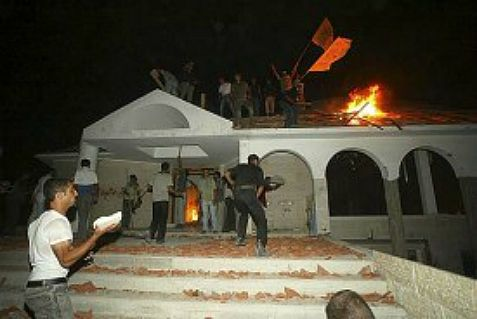 Peace at last: Palestinians celebrating the sanctity of the synagogue in Netzarim in Gaza after the IDF expelled the local Jewish families in 2005.