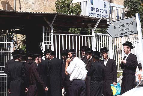 A smattering of Haredi yeshiva students standing outside the IDF Recruitment Office in Jerusalem. The mass demonstration organized for today is part of a giant fix, arranged between the anti-Haredi Finance Minister Yair Lapid and the Haredi establishment.