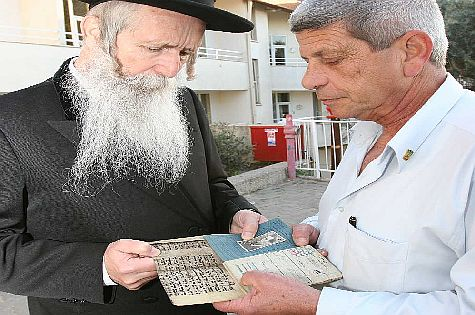 Rabbi Grossman receives the parchmen from Mr. Dotan