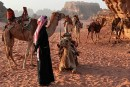 Bedouin with his camels at Wadi Run Desert.