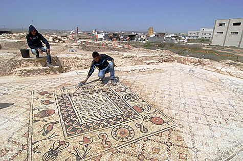 Working on a Byzantine mosaic in the Negev. (file)