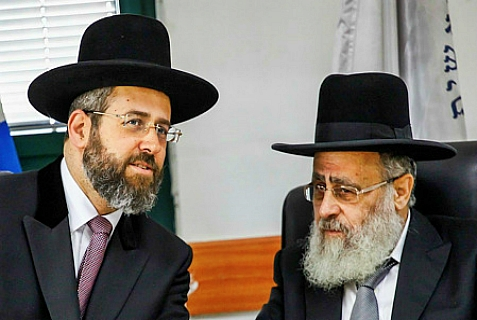 Chief Ashkenazi Rabbi David Lau (L) and Sephardi Chief Rabbi Yitzhak Yosef attend a meeting of the Rabbinate Council in Jerusalem on November 04, 2013.