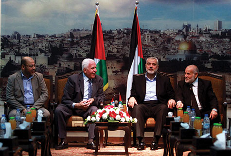 (L-R) Senior Hamas leader Moussa Abu Marzouk; senior Fatah official Azzam Al-Ahmed; head of the Hamas government Ismail Haniyeh; and deputy speaker of Palestinian Parliament Ahmed Bahar in Gaza City.