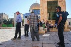Jews are watched by guards on the Temple Mount, to make sure they don't pray.