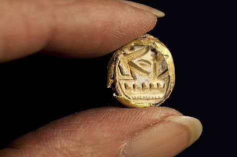 Gold scarab with symbol of Pharaoh Seti I set in a ring found in a 3,300 year old coffin in the Jezreel Valley