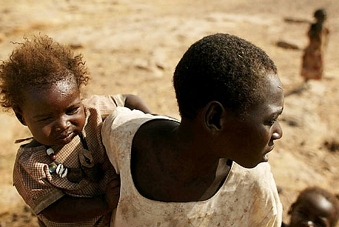 Woman with babies fleeing genocide in Darfur.