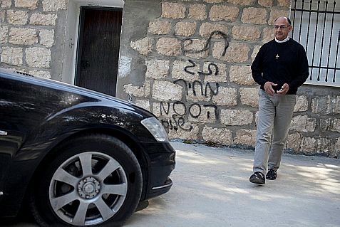 Slashed tires and Hate-graffiti spray painted on a Catholic monastery near Beth Shemesh, west of Jerusalem.