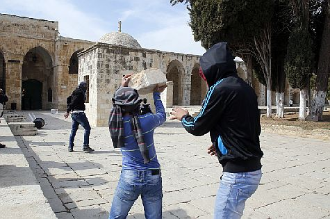 Muslim believers in Allah throw rocks at Jews on the Temple Mount.
