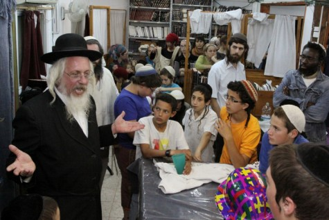 Bat Ayin children with local Rabbi Natan Greenberg. Apparently the police feel their civil rights are negotiable
