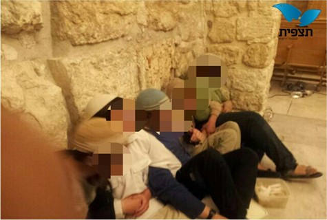 Youths chain themselves together in David's Tomb, in protest. Photo by: Tazpit News Agency