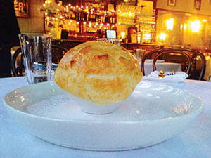 "Onion soup ""en croute"" (caramelized onions in duck consommé topped with crispy pastry hat)."