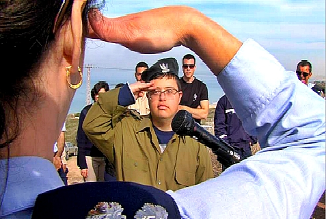 A member of the Great in Uniform IDF project is saluted