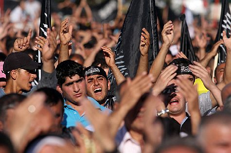Hizb ut-Tahrir (Islamic Liberation Party) supporters at a rally in the PA capital of Ramallah, 2012.