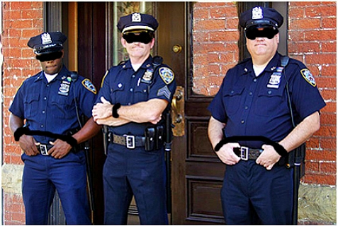 NYPD officers blindfolded by new regulations.