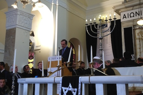 Prime Minister Antonis Samaras of Greece speaking at a synagogue in Thessaloniki, the first visit by a sitting prime minister to a Greek shul in more than a century,