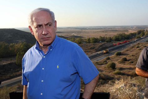Prime Minister Netanyahu has been to Sderot numerous times. Here he surveys Gaza from the city, 2010.