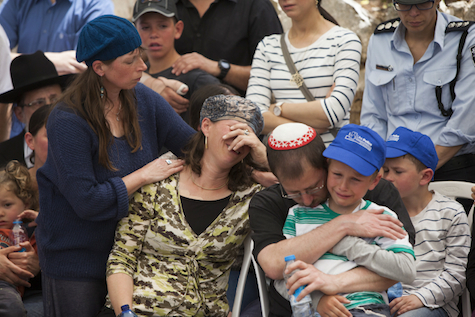 Family of Baruch Mizrahi mourn at his funeral. No one asked Mizrahi if he wanted to live or die.