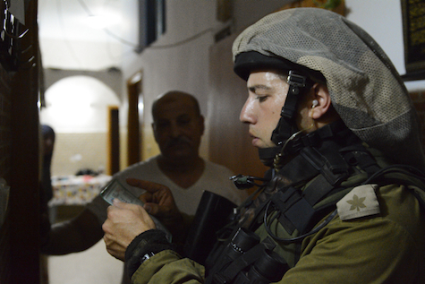 IDF Soldier checks Palestinian IDs in the Balata Refugee Camp Wednesday