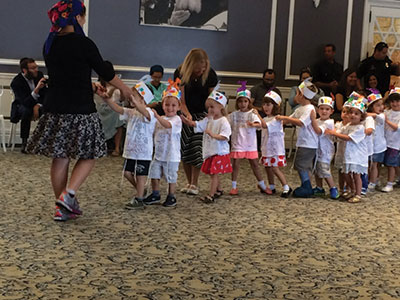 Children in pre-Montessori class performing at year-end celebration.
