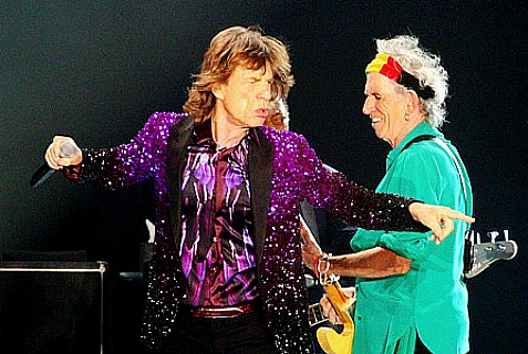 The Rolling Stones frontman, Mick Jagger (L), and guitarist, Keith Richards (R), on stage during the band's concert in Tel Aviv, Israel, on June 4, 2014.