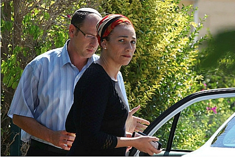 Ofir (L) and Bat Galim (R) Sha'ar, parents of missing Israeli teen, Gilad Sha'ar, seen leaving their home on June 18, 2014, to meet with Minister of Defense Moshe Yaalon.