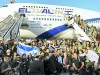 New immigrants from USA and Canada arriving at Ben Gurion Airport on August 14, 2012. The immigrants are part of Nefesh Be Nefesh (soul to soul) organization that brings immigrants from western countries to Israel.