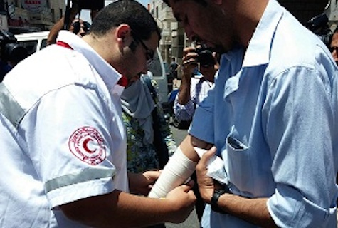 Palestinian paramedic treats journalist Firas Tannina