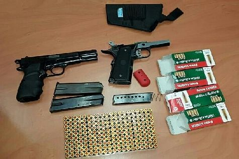 Guns, cartridges and ammunition seized in raid by Israeli security personnel at Azaria on June 2, 2014.