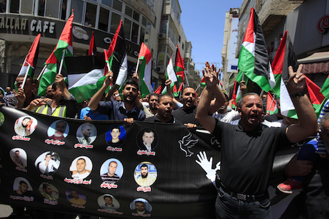 Arabs demonstrate in solidarity with murderers in Ramallah