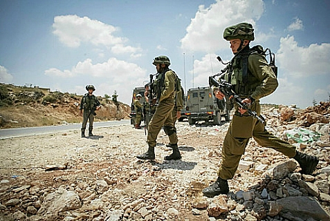 IDF soldiers searching for missing Israeli teens believed kidnapped on June 12, 2014.