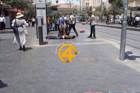 Security forces tackle and handcuff suspect in Jerusalem