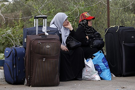 Arabs on the Rafah border waiting to cross waiting to leave.