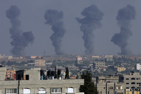 Black smoke rises over Gaza City following Israeli air strikes on Hamas targets.