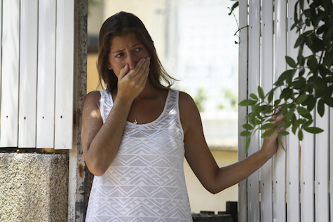 A woman examines the damage from a Grad rocket in Ashdod,