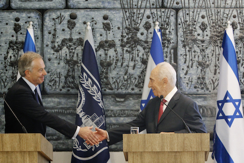 Shimon Peres and Tony Blair shake hands in Jerusalem.