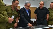IDF officials brief Prime Minister Netanyahu on July 9, 2014. The prime minister visited wounded IDF soldiers Tuesau