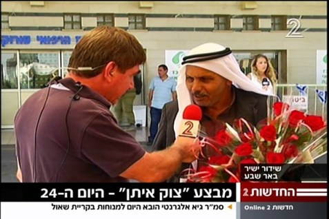An Arab sheikh hands out flowers in a gesture of brotherhood and good will.