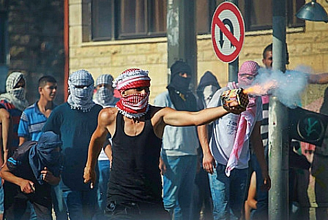 Palestinian Arabs clash with Israeli border police in the Jerusalem neighborhood of Shuafat, following the reports of the body of an Arab teen who was found killed in the Jerusalem forest. July 02, 2014.
