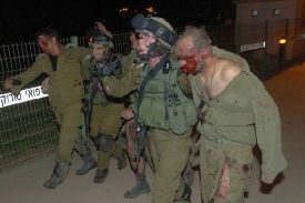 Wounded Israeli soldiers are carried into Soroka hospital in Be'er Sheva; five were hurt in October 2013 when an explosive device went off as troops were clearing a tunnel from Gaza into Israel to be used for infiltration to carry out terror attacks.