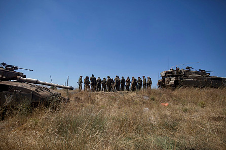 Israeli soldiers seen during patrol in the Golan Heights after a 15-year-old Israeli boy was killed Sunday morning, June 22, 2014. On July 13, another shell was fired into Israel from Syria.