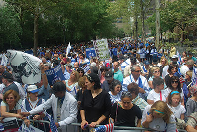Thousands of people gathered at Dag Hammarskjold Plaza in Manhattan Monday to voice support for Israel's military operations against Hamas terrorists in Gaza. The rally was sponsored by UJA-Federation of New York and the Jewish Community Relations Council of New York, along with a number of co-sponsoring organizations spanning the spectrum of the organized Jewish community. Elected officials who addressed the rally included Sen. Charles Schumer and Representatives Elliot Engel, Grace Meng, Steve Israel, and Hakeem Jeffries. Israel's consul general in New York, Ido Aharoni, also spoke.