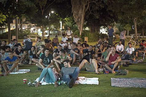 Tel Aviv residents watch the World Cup shortly after a Color Red incoming rocket alert siren has sounded.