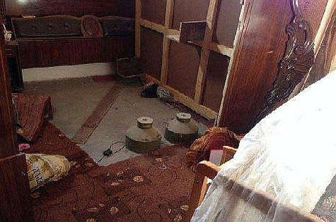 Bombs and wiring placed next to baby's cradle in Gaza.