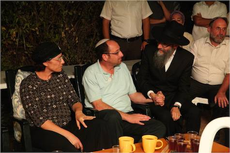 Singer Avraham Fried comforts Bat-Galim and Ofer Sha'ar