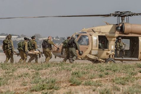 An injured Israeli soldier is evacuated by helicopter from near the Israeli border with Gaza Strip on July 21, 2014, following heavy fighting between Israeli soldiers and Gaza terrorists.