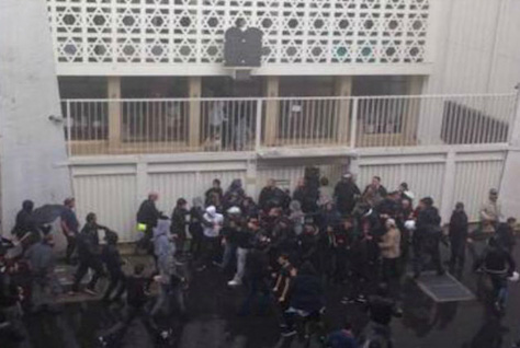 Anti-Israel protesters try to enter a synagogue in Paris.